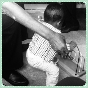 Munchkin gets assistance from Great-granddaddy on how to use the abacus that Mommy used to play with as a little girl.