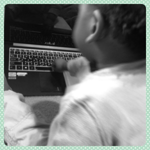 While Munchkin is focused on the task at hand, Mommy tries to get as much work done as she can.